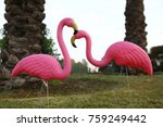a pair of plastic flamingos in... | Shutterstock . vector #759249442