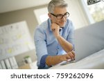 architect in office working on... | Shutterstock . vector #759262096
