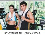 sport man and woman with towel... | Shutterstock . vector #759264916