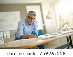 architect in office working on... | Shutterstock . vector #759265558