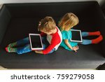 little boy and girl looking at... | Shutterstock . vector #759279058