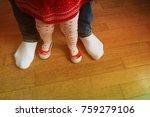 father helping little daughter... | Shutterstock . vector #759279106