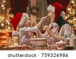 Small photo of Merry Christmas and Happy Holidays. Family preparation holiday food. Mother and daughter cooking cookies.