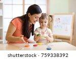 woman teacher play with... | Shutterstock . vector #759338392