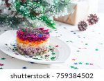 Stock photo new year s salad herring under the fur coat on a white plate in the christmas decorations 759384502