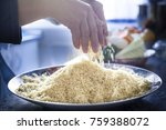 Small photo of A Detail shot of rising dynamic chef woman hands preparing a delightful and tasty plate of traditional moroccan couscous, with trepidation in the wheat grains to achieve movement effect.