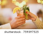 two cocktail glasses in man and ...   Shutterstock . vector #759397525