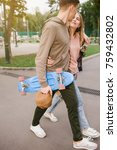 teenage couple dating in a park.... | Shutterstock . vector #759432802