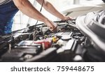 auto mechanic working in garage....