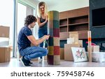 couple unpacking moving boxes... | Shutterstock . vector #759458746