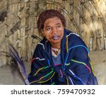 Small photo of 2014, Aug 25, Kwazulu Natal, Africa: Sangoma, a traditional Zulu healer, in ancestral clothing inside a beehive hut. She is a spirit medium for the Zulu people; the cow-tail whisk signifies dignity.