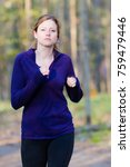 woman running in wooded forest... | Shutterstock . vector #759479446