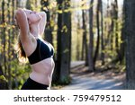 young woman in sports bra on... | Shutterstock . vector #759479512