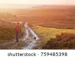a hiker and their dog walking... | Shutterstock . vector #759485398