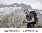 hiker looks for the right way... | Shutterstock . vector #759504676