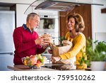 senior couple preparing food in ... | Shutterstock . vector #759510262