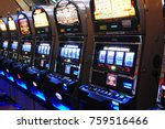 Small photo of Atlantic City, NJ, SUA August 16, 2010 Slot machines, also known as one arm bandits, await the next player at a casino in Atlantic City, New Jersey