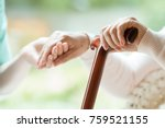Elder Person Using Wooden...