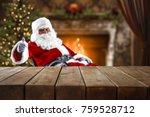 Santa Claus At The Table Where...
