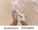 Woman Legs Stands In Sea Water...