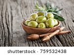 green olives on a wooden board | Shutterstock . vector #759532438
