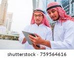 two arabic muslim wear white... | Shutterstock . vector #759564616