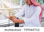 arabic muslim wear white shirt... | Shutterstock . vector #759564712