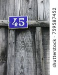 Small photo of Close-up of a number on a wooden hut in port of Biganos, Gironde, France