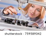 a female student or laboratory... | Shutterstock . vector #759589342