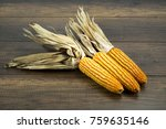 dry corn on wooden background.  ... | Shutterstock . vector #759635146