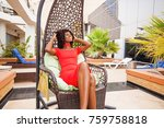 beautiful african woman sitting ... | Shutterstock . vector #759758818