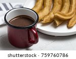 typical spanish churros with... | Shutterstock . vector #759760786