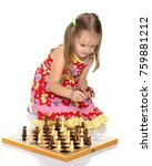a little girl is playing chess. ... | Shutterstock . vector #759881212