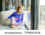 a 3 year old child looks at the ... | Shutterstock . vector #759892936