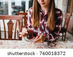 beautiful young girl sitting at ... | Shutterstock . vector #760018372