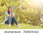 asian woman in glasses thinking ... | Shutterstock . vector #760024162