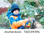 little kid boy feeding birds in ... | Shutterstock . vector #760159396
