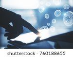 backlit hand using tablet with... | Shutterstock . vector #760188655