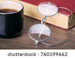 a cup of coffee with a book and ... | Shutterstock . vector #760199662