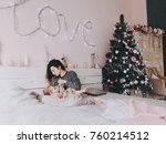 a young curly haired mother in... | Shutterstock . vector #760214512