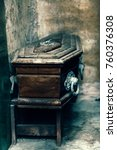 small coffin inside a mausoleum. | Shutterstock . vector #760376308