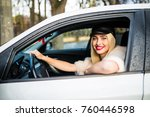 young beauty woman driving her...   Shutterstock . vector #760446598