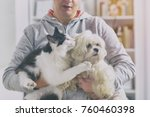 Stock photo pet owner with dog and cat at home 760460398