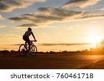 a man ride a bicycle at sunset... | Shutterstock . vector #760461718