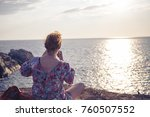 young and blonde woman taking a ... | Shutterstock . vector #760507552