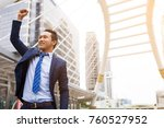 businessman smiling and raising ... | Shutterstock . vector #760527952