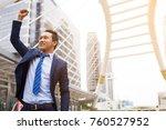 businessman smiling and raising ... | Shutterstock . vector #760527952
