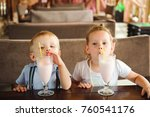 little boy and girl drinking... | Shutterstock . vector #760541176