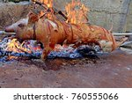 suckling pig on a rotating spit ... | Shutterstock . vector #760555066