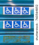 Small photo of Garage door with accessibility signage